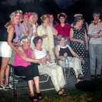 The Polish women wearing chaplets signaling that they are ready to be married. According to Polish tradition on mid-summer day the chaplets were threw into a river so a future husband would pick them up.